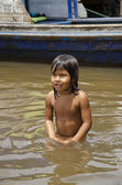 A girl in the Amazon River — Stock Photo