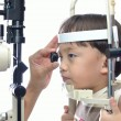 Stock Photo: Boy eye examination
