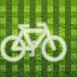 Bicycle on grass field - Stock Photo