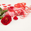 Stock Photo: Red rose and gift on a white background