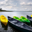 Stock Photo: Green and yellow kayaks