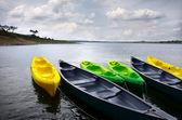 Green and yellow kayaks — Stock Photo