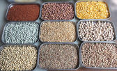 Indian pulses and cereals on display in a shop at bangalore market — Stock Photo