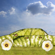 Green car concept made from leaves and flowers — Stock Photo