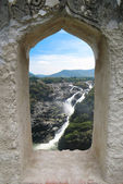 Waterfall through a fort window — Stock Photo