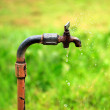 Old rusty tap with water leaking — Stock Photo
