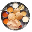 Traditional south indian lunch with puri and sambar - Stock Photo