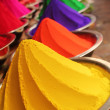 Colorful piles of powdered dyes on display - Stok fotoğraf