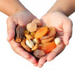 Woman holding bunch of dry fruits isolated on white — Stock Photo