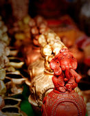 Lord Ganesh idol made of clay and painted red — Stock Photo