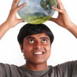 Young man smiling and holding ball with ecosystem — Stock Photo