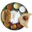 Постер, плакат: South indian plate lunch on banana leaf on white