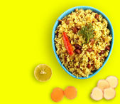 Spicy south indian breakfast chitranna or poha — Stock Photo
