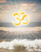Hindu religious symbol om or aum against sun shine — Stock Photo