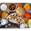 Traditional north indian plate meals or lunch with roti — Stock Photo
