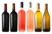 Mixed wine bottles on white — Stock Photo