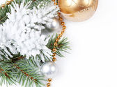 Golden decorations and fir branch — Stock Photo