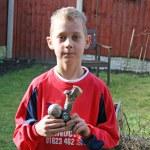 Teenage boy with football award — Stock Photo