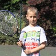 Boy playing tennis — Stock Photo #10343045
