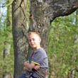 Teenage boy in the forest - Stock Photo