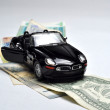 Black sport car and money - Stock Photo