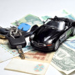 Car keys and money - Stock Photo