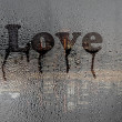 Love , text on condensation window, after rain — Stockfoto #9522193