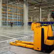 Electric forklift in storehouse - Stock Photo