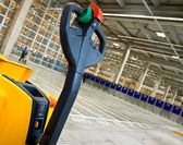 Cropped forklift in warehouse — Stock Photo