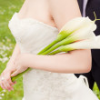 Bride holding flowers — Stock Photo