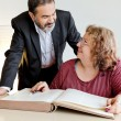 Adult couple behind book - Stock Photo