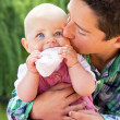Little boy kissing baby sister — Stock Photo