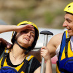 Happy couple rafting equipment — Stock Photo