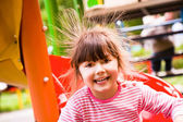 Happy girl static electricity — Stock Photo