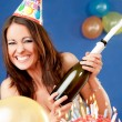 Excited female birthday champagne — Stock Photo