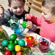 Stock Photo: Boys dyeing eggs easter fun