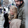 Homeless couple struggle city centre — Stock Photo
