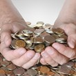 Stock Photo: Lot of coins in hands of men
