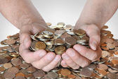 A lot of coins in the hands of men — Stock Photo