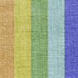 Linen texture in the rainbow colors — Stock Photo