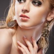 Beautiful woman with evening make-up and Jewelry — Stock Photo #10693525