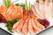 Set of Sashimi on Daikon with Seaweed, Cucumber — Stock Photo