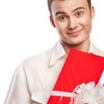 Smiling man holding gift isolated on white — Stock Photo