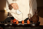 A young man holds a Chinese tea ceremony — Stock Photo