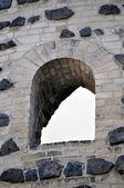 Window in a old stone wall. — Stock Photo