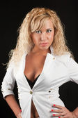 Beautiful blonde in a white jacket — Stock Photo