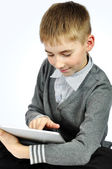 Boy with touch pad — Stock Photo