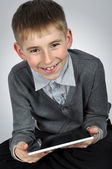 Boy with tablet pc — Stock Photo