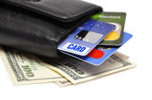 Credit cards and dollar banknotes — Stock Photo
