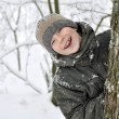 Smiling boy in winter forest — Stock Photo #8632977